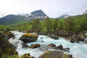 Beautiful spring Norway landscape with river rapids and mountains